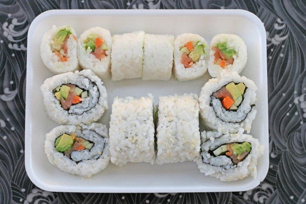 sushi with smoked salmon, carrot, avocado, and cucumber